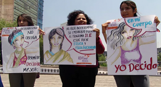 Pro-abortion protesters claim the right to decide for themselves
