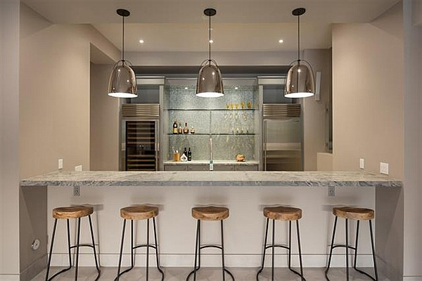 A bar area downstairs adds another wine cooler, refrigerator, ice maker...