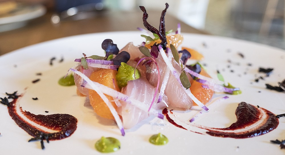 A hibiscus and smoked chili coulis, plus crispy hibiscus flowers, dress a yellowtail tiradito