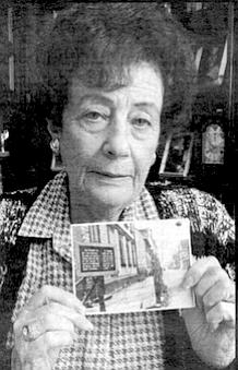 Fanny Lebovits with photo of Liepaja ghetto.