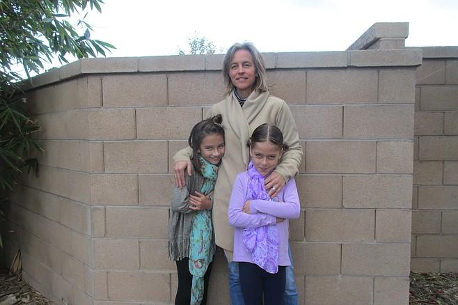 Sarah, Suzanne, and Ella Hagen at the wall