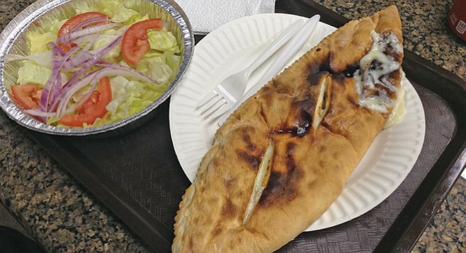 The calzone looks straight out of rustic Italy.