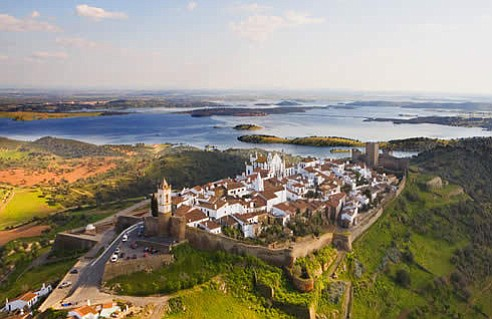 Monsaraz is a small medieval hilltop town overlooking the water in Southern Portugal (Photo by Hurtuv, 2014)