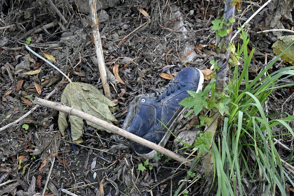 A discarded shoe in the San Diego River bed.
