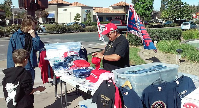 Trump stuff at the corner of Mission Gorge Road and Town Center Parkway in Santee.