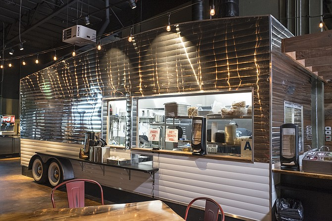 Dressed up with stainless steel siding and tires, the kitchen is intended to resemble an Airstream trailer.