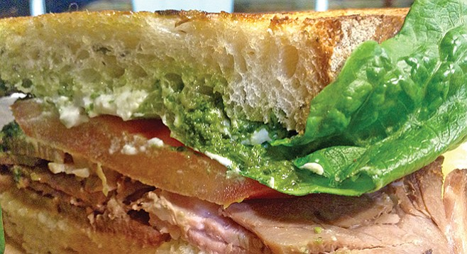 Pesto and rosemary and olive oil bread infuse the lamb with flavors