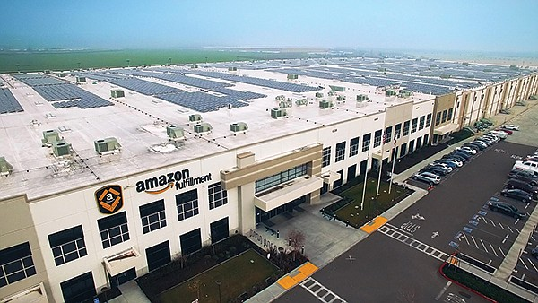 Solar equipment on the roof of an Amazon fulfillment center
