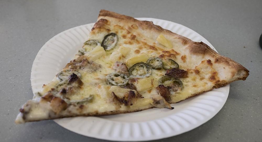 Crispy crust on a pork belly pizza.