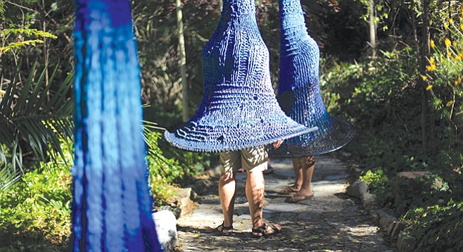 Michelle Montjoy's giant, indigo, bellflower-like shapes on display at Ship in the Woods.