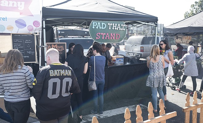 The Pad Thai Stand at Hillcrest Sunday farmers market, chef Nat Thitathan cooking.