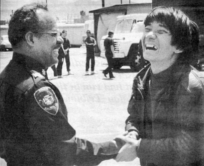 Chinese man shaking hands with Ensenada policeman