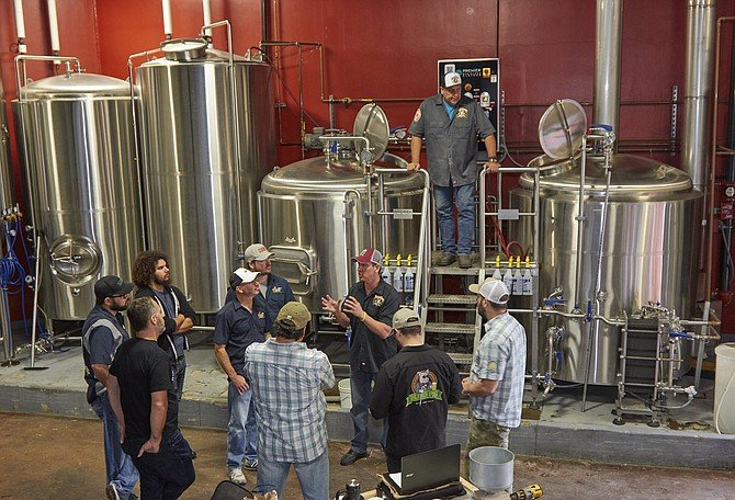 QUAFF members and Indian Joe brewers collaborate on a fundraising beer.