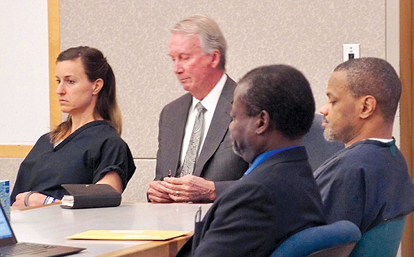 Diana Lovejoy (Mulvihill's estranged wife) and McDavid sit with their attorneys during trial. Lovejoy did not testify, McDavid did — with disastrous consequences.