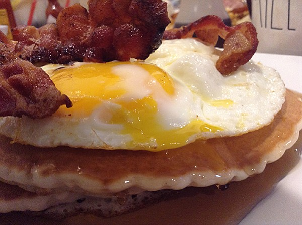 Short stack plus three bacon rashers and three sunny-side-up eggs