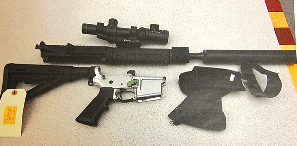 """McDavid's rifle. """"The AR platform is an extension of my body,"""" he boasted at trial."""