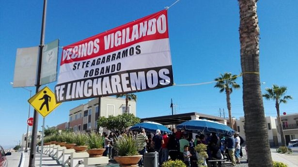 """Warning posted in Hacienda Los Laureles neighborhood: """"Neighbors Watching. If we catch you stealing, we will lynch you."""""""