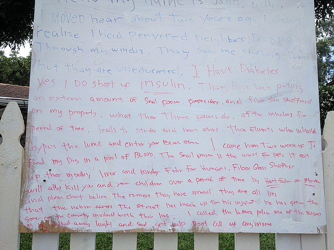 Sign John referenced in this story posted in his front yard to explain himself