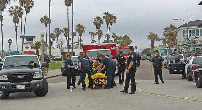 EMTs/Paramedics attending to emergency call in O.B.