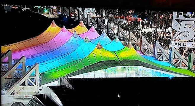 With a Fox 5 drone overhead to capture the scene, the sail scrolled through several solid colors while triumphant-sounding music played