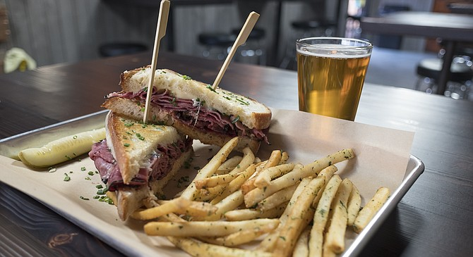A Reuben for $9, with beer and fries for $5 more