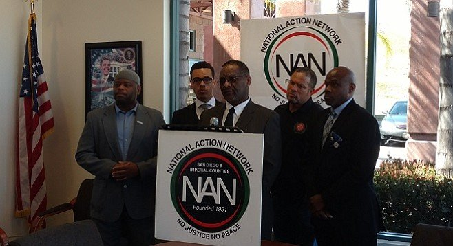 Aerospace machinist Jamil Couzens (center) alleges racial discrimination in the industry's hiring practices