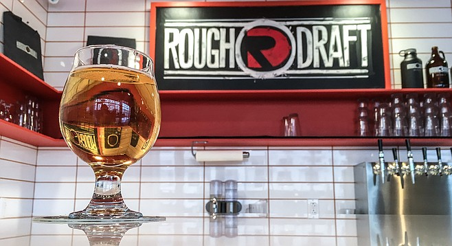 A glass of Mesa Nueva Mexican lager, brewed for the grad students attending Rough Draft's Mesa Nueva tasting room.