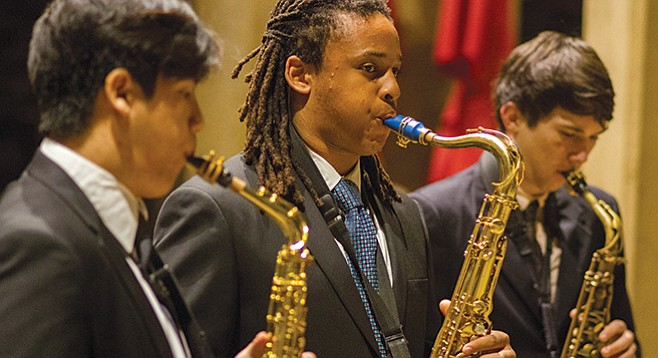 Teenaged saxophonists Tiger Diep (left) and Alvin Paige (center) are two of the young jazz musicians in the Young Lions program.