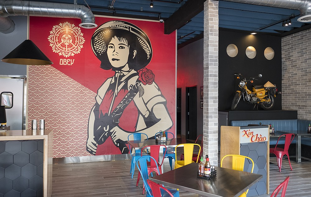 Scooters, conical hats, and a Shepard Fairey print contribute to Shank & Bone's ready for North Park vibe.