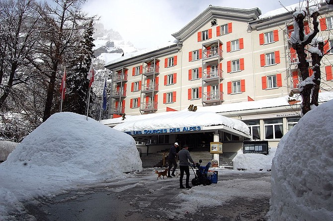Clearing the snow at the five star Les Sources des Alpes Hotel & Spa in Leukerbad.