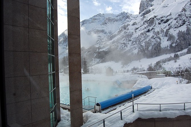 The outdoor pool at the Walliser Alpentherme & Spa complex where one can bathe amidst the winter splendor.