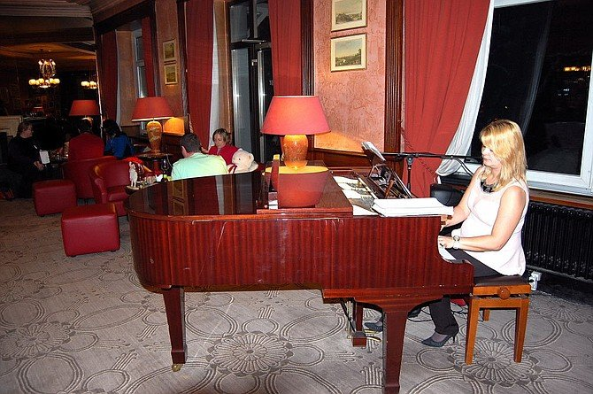 The piano player in the lobby bar of the five star Les Sources des Alpes Hotel & Spa in Leukerbad.
