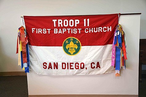 The troop flag was spared as it was stored inside the church.