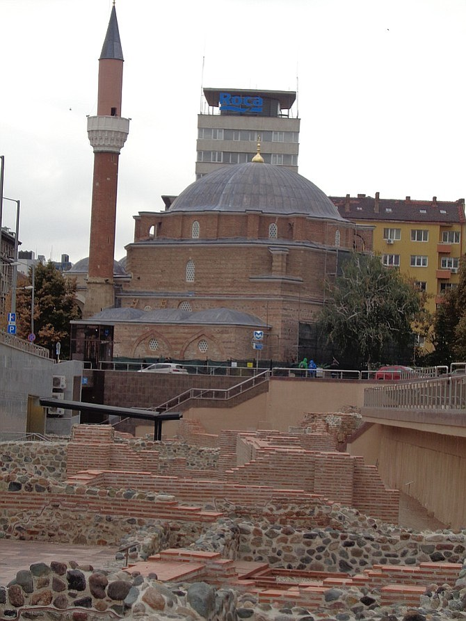 Modern buildings and old mosque above ancient Roman ruins at the Serdika Metro station.