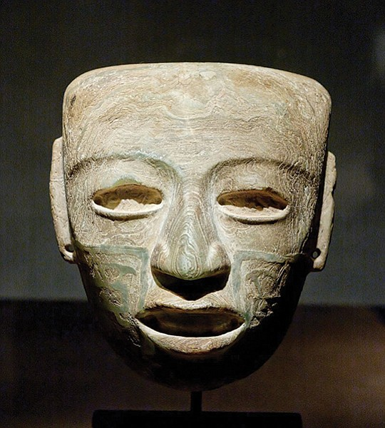 Most of the masks are carved from greenstone and polished to a glassy Brancusian sleekness.