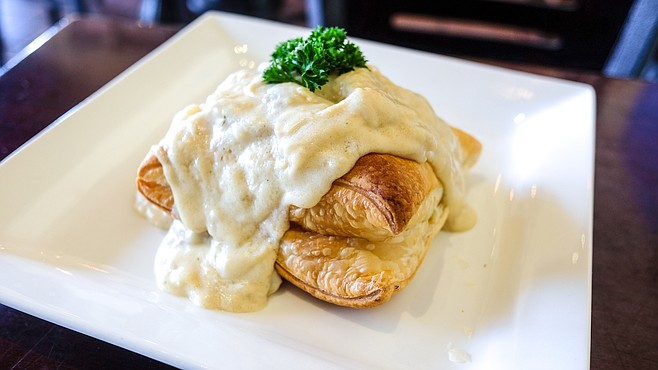 Chicken in a pastry puff, smothered in gravy. It tastes like a chicken pot pie.