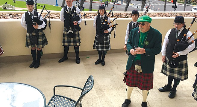 Michael Welch, Captain of the 666 Irish Division Rebels, introduces the Helix High bagpipe band.