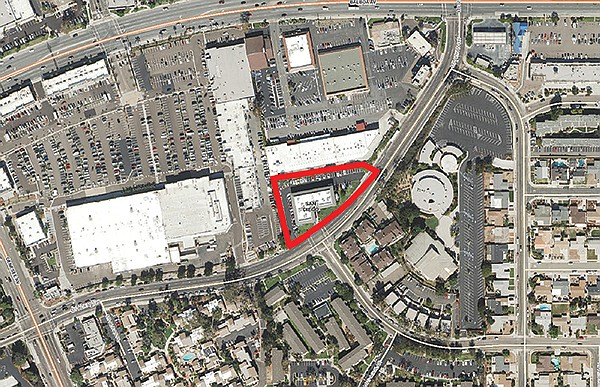 The proposed housing location at 5858 Mt. Alifan, across a strip mall from the intersection of Genessee and Balboa Avenues, is currently an office building.