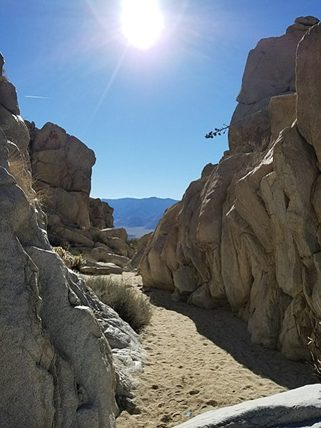 Trail leads through a narrow gorge to a spectacular view of Vallecito Valley