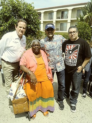 """Mayor Morrison with residents. """"He said he's trying to put more affordable housing in the city."""""""