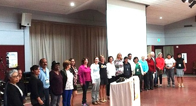 """Meeting at St. James, next to Eden Gardens in Solana Beach. Spokeswoman Caroline Theiss-Aird (left of podium, in black) : """"70 percent of these people had no criminal record."""""""