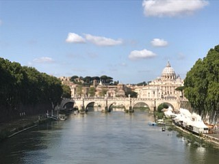 View of Saint Peter's Basilica from the Ponte Saint Angelo bridge in Rome, Italy.