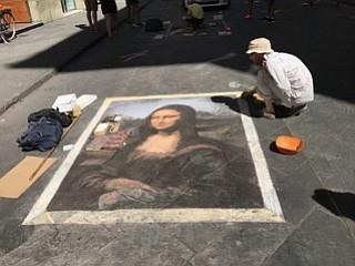 Appreciating art on the Palazzo Vecchio in Florence.