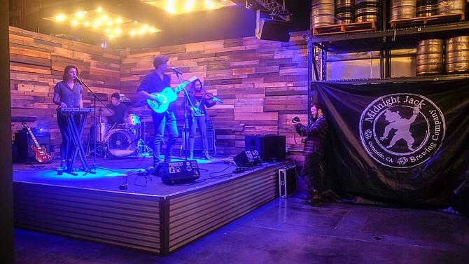 J. Hoftsee and band perform at Midnight Jack Brewing