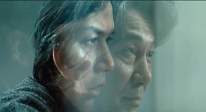 The face on the perspex wall. Masaharu Fukuyama and Kôji Yakusho compound their grief in Hirokazu Kore-Eda's exquisite The Third Murder.