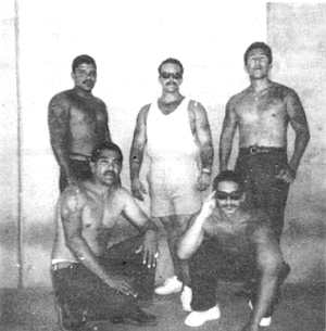 Sammy Santos, standing, left. One of the bullets pierced Santos's heart and lung.