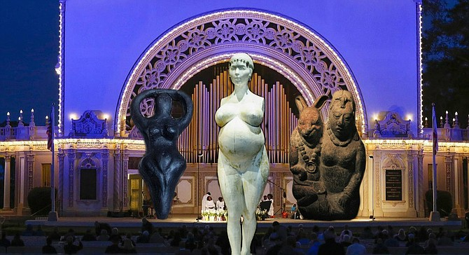 """Prior to the rites, worshippers paid homage to fertility symbols from various cultures, from ancient Sumeria to the more modern Cult of Celebrity. The central statue was a super-sized (but still perfectly proportional) rendition of LA artist Daniel Edwards' statue of pregnant Kim Kardashian. After disrobing and prostrating herself before the statue of Oester and her Rabbit Consort (right), 54-year-old North Park resident Elaine Pagan granted that she """"usually likes her Easter Bunnies on the cuter, more cuddly side, but I guess when you start celebrating leporine breeding capacity, you're dealing more with a wild hare up your…well."""""""