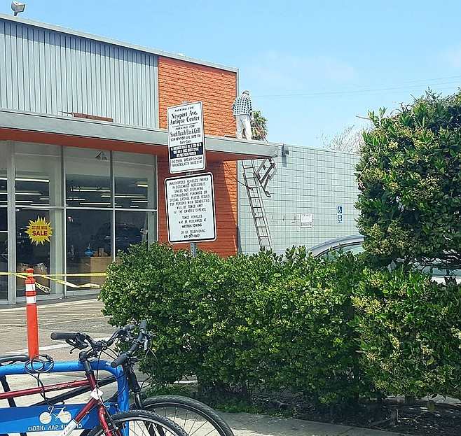 Antique Center's sign came down on Monday (April 16).