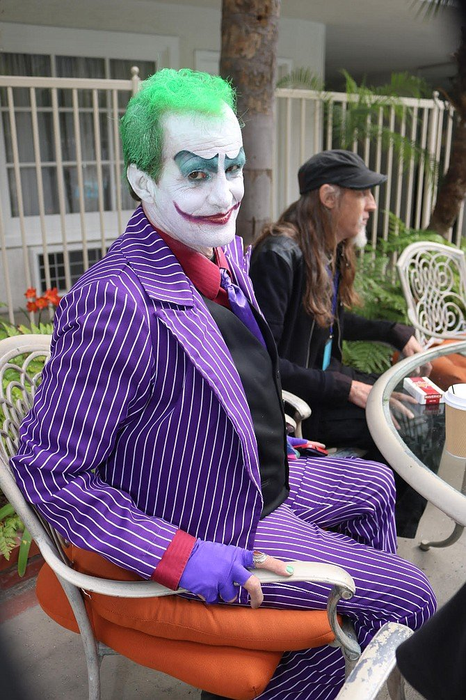 Doc, who cosplayed as the Joker, reached down into his Gumby socks and pulled out his stash.