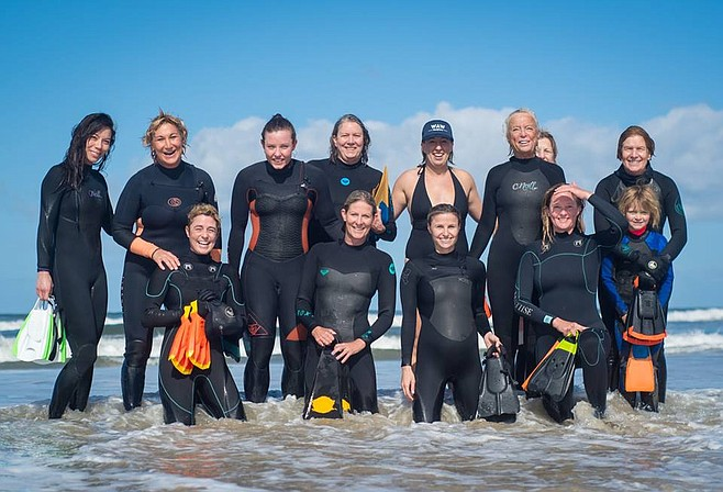 Club members broke the world record for the largest number of female bodysurfers on one wave — thirteen.